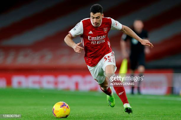 Arsenal's Brazilian striker Gabriel Martinelli runs with the ball during the English Premier League football match between Arsenal and Chelsea at the...