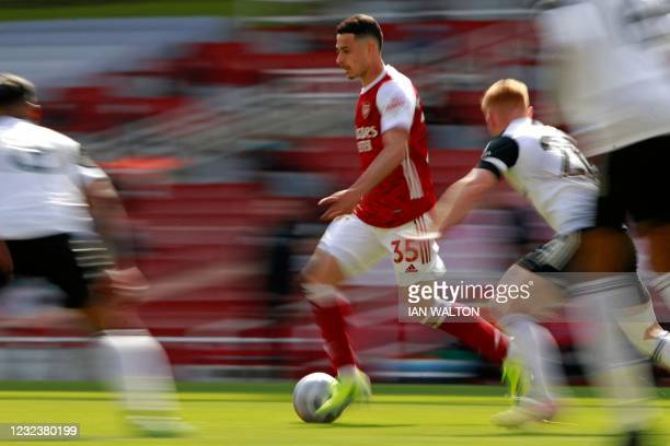 Arsenal's Brazilian striker Gabriel Martinelli runs with the ball during the English Premier League football match between Arsenal and Fulham at the...
