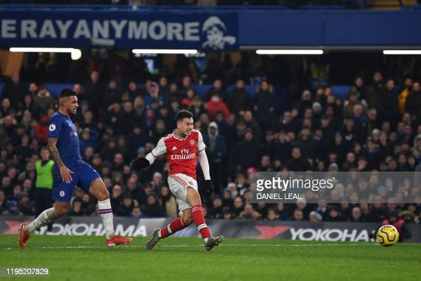 Arsenal's Brazilian striker Gabriel Martinelli scores their first goal to equalise 1-1 during the English Premier League football match between...