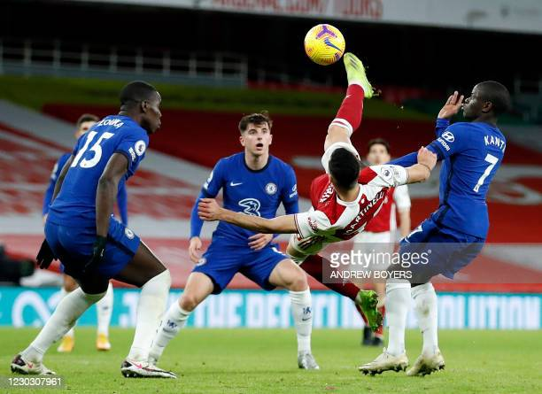 Arsenal's Brazilian striker Gabriel Martinelli shoots but fails to score with an overhead kick during the English Premier League football match...