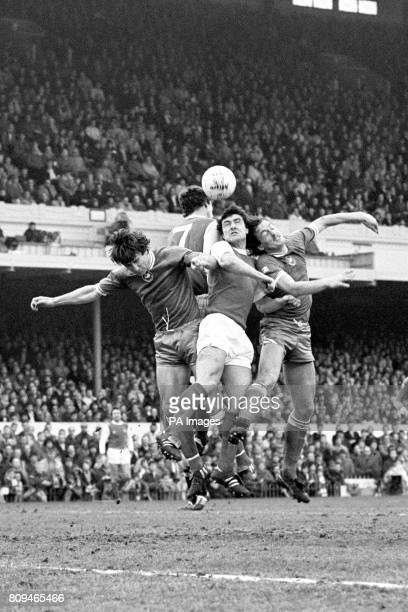 Arsenal's Brian Talbot is sandwiched between Ante Rajkovic and Garry Stanley of Swansea City with Paul Vaessen at the rear