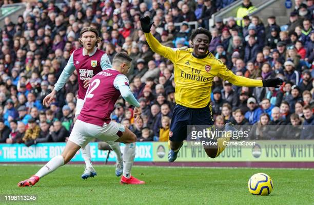 Arsenal's Bukayo Saka is fouled by Burnley's Matthew Lowton during the Premier League match between Burnley FC and Arsenal FC at Turf Moor on...