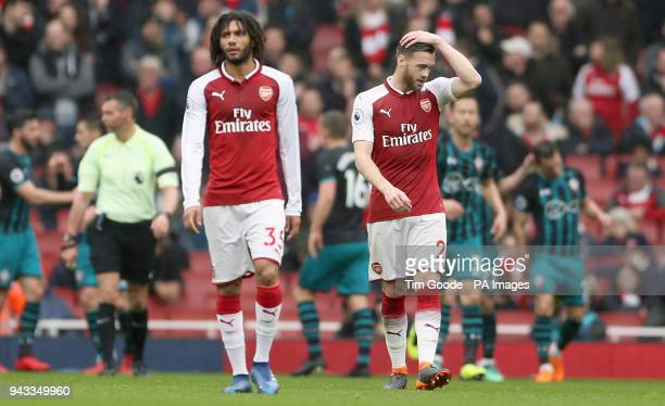 Arsenal's Calum Chambers and Mohamed Elneny appear dejected after Southampton's Shane Long scores his side's first goal of the game during the...