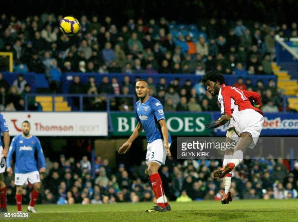 Arsenal's Cameroonian defender Alexandre Song scores the fourth goal during their English Premier League football match against Portsmouth at Fratton...