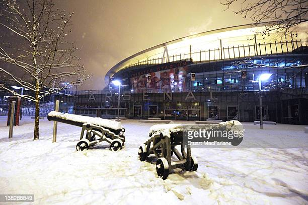 Arsenal's cannons are covered with snow outside The Emirates Stadium, the home of Arsenal FC, on February 05, 2012 in London, England. Heavy snowfall...