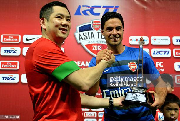 Arsenal's Captain Mikel Arteta receives the trophy from Hary Tanoesoedibjo MNC and RCTI President's after friendly match with Indonesia Dream Team at...