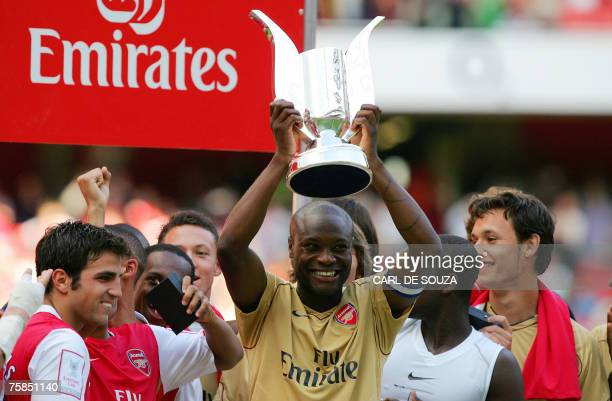 Arsenal's Captain William Gallas of France holds up the Emirates Cup trophy after winning their Emirates Cup match against Inter Milan at the...