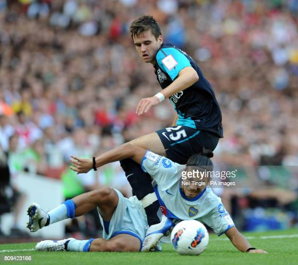 Arsenal's Carl Jenkinson and and Boca Juniors' Walter Erviti during the Emirates Cup match at the Emirates Stadium London