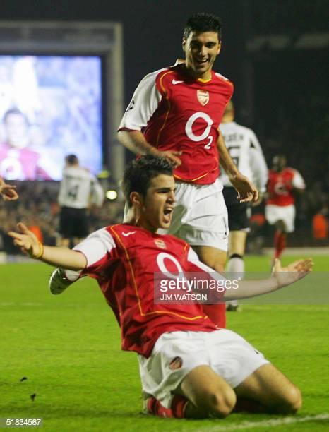 Arsenal's Cesc Fabregas celebrates scoring against Rosenborg with teammate Jose Antionio Reyes during their Champions League football match at...