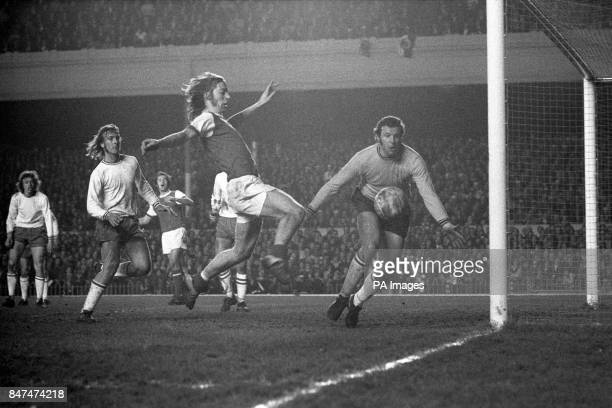 Arsenal's Charlie George lashes the ball at goal from close range watched by Ajax Amsterdam goalkeeper Stuy but the shot goes wide