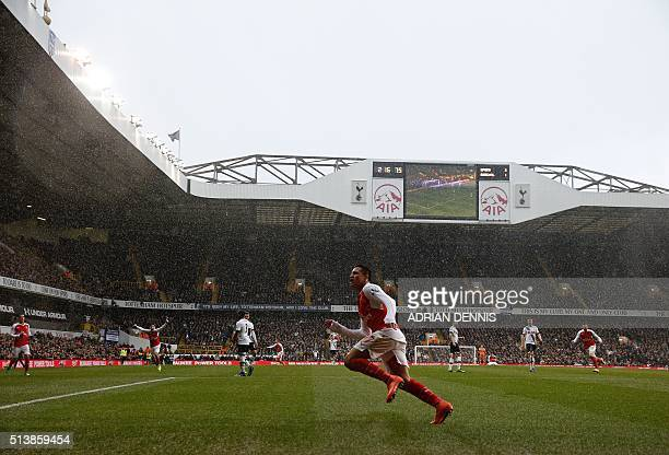 Arsenal's Chilean striker Alexis Sanchez celebrates after scoring their second goal during the English Premier League football match between...