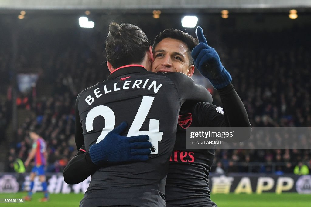 Arsenal's Chilean striker Alexis Sanchez celebrates after scoring their third goal with Arsenal's Spanish defender Hector Bellerin (L) during the English Premier League football match between Crystal Palace and Arsenal at Selhurst Park in south London on December 28, 2017. / AFP PHOTO / Ben STANSALL / RESTRICTED TO EDITORIAL USE. No use with unauthorized audio, video, data, fixture lists, club/league logos or 'live' services. Online in-match use limited to 75 images, no video emulation. No use in betting, games or single club/league/player publications. /