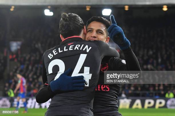 Arsenal's Chilean striker Alexis Sanchez celebrates after scoring their third goal with Arsenal's Spanish defender Hector Bellerin during the English...