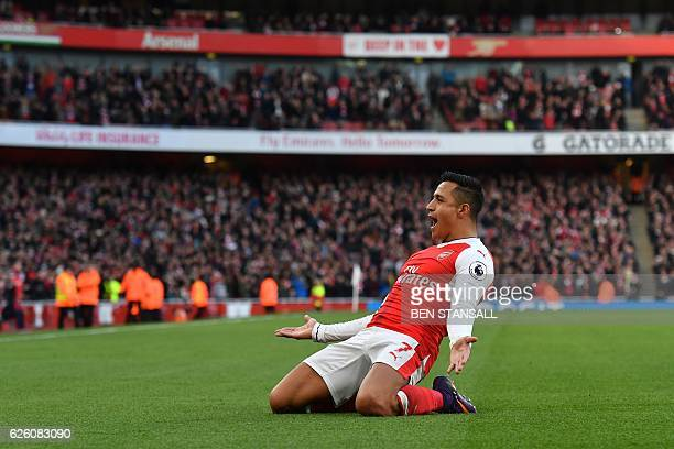 Arsenal's Chilean striker Alexis Sanchez celebrates after scoring the opening goal of the English Premier League football match between Arsenal and...