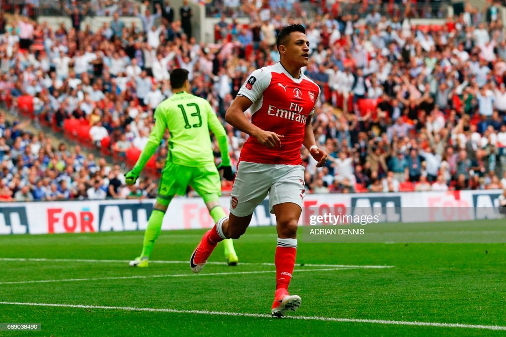 Arsenal's Chilean striker Alexis Sanchez (R) celebrates after scoring the opening goal of the English FA Cup final football match between Arsenal and Chelsea at Wembley stadium in London on May 27, 2017. / AFP PHOTO / Adrian DENNIS / NOT