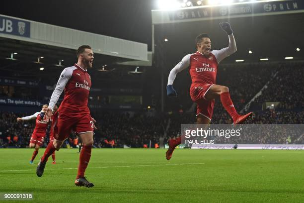 Arsenal's Chilean striker Alexis Sanchez celebrates after scoring the opening goal with a deflected free kick during the English Premier League...