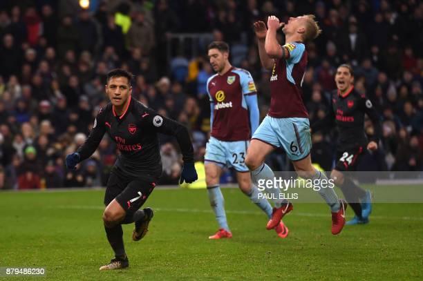 Arsenal's Chilean striker Alexis Sanchez celebrates scoring a penalty as Burnley's Irish defender Stephen Ward and Burnley's English defender Ben Mee...
