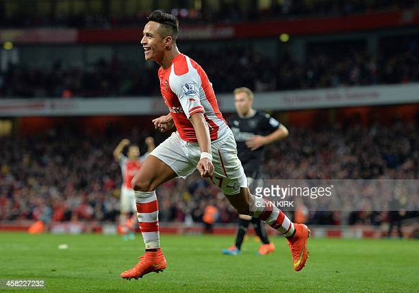 Arsenal's Chilean striker Alexis Sanchez celebrates scoring his team's third goal during the English Premier League football match between Arsenal...