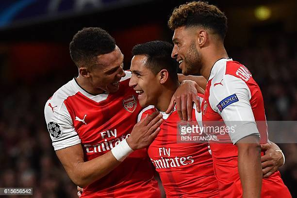 Arsenal's Chilean striker Alexis Sanchez celebrates scoring his team's first goal during the UEFA Champions League Group A football match between...