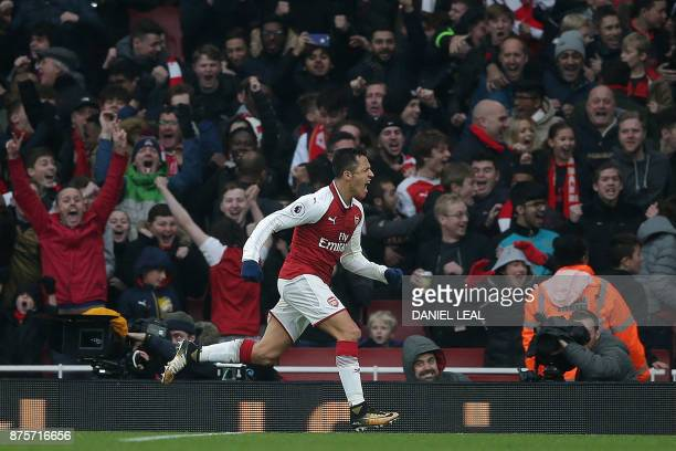 TOPSHOT Arsenal's Chilean striker Alexis Sanchez celebrates scoring his team's second goal during the English Premier League football match between...