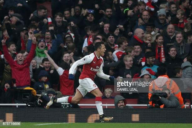 TOPSHOT Arsenal's Chilean striker Alexis Sanchez celebrates scoring his team's second goal during the English Premier League football match between...