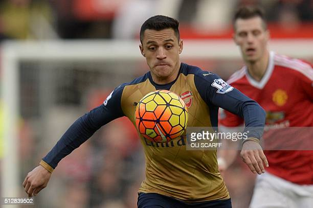 Arsenal's Chilean striker Alexis Sanchez chases the ball during the English Premier League football match between Manchester United and Arsenal at...