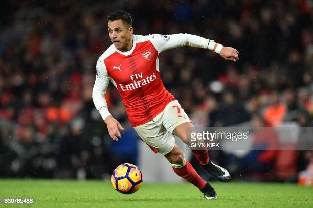 Arsenal's Chilean striker Alexis Sanchez controls the ball during the English Premier League football match between Arsenal and Crystal Palace at the...