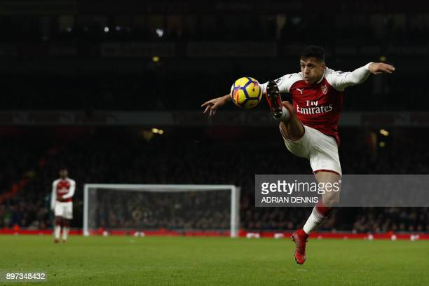 Arsenal's Chilean striker Alexis Sanchez controls the ball during the English Premier League football match between Arsenal and Liverpool at the...