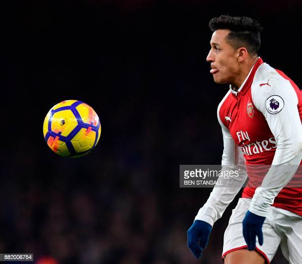 Arsenal's Chilean striker Alexis Sanchez eyes the ball during the English Premier League football match between Arsenal and Huddersfield Town at the...
