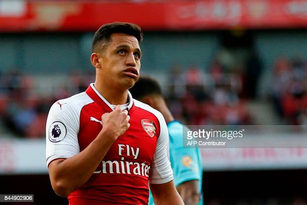 Arsenal's Chilean striker Alexis Sanchez gestures during the English Premier League football match between Arsenal and Bournemouth at the Emirates...