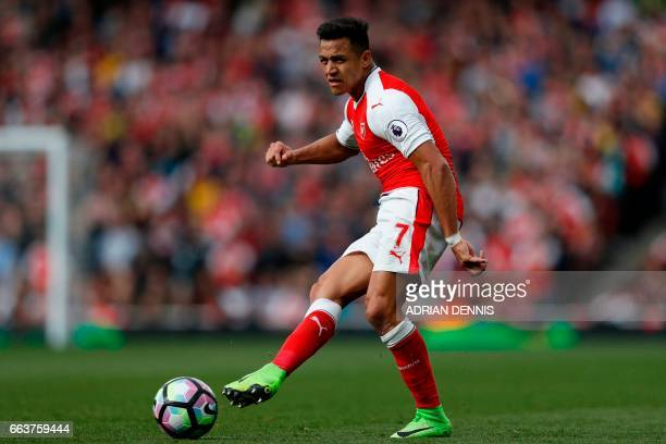 Arsenal's Chilean striker Alexis Sanchez passes the ball during the English Premier League football match between Arsenal and Manchester City at the...