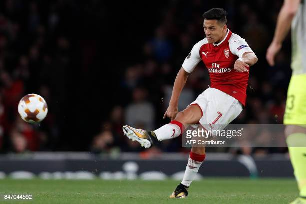 Arsenal's Chilean striker Alexis Sanchez passes the ball during the UEFA Europa League Group H football match between Arsenal and FC Cologne at The...