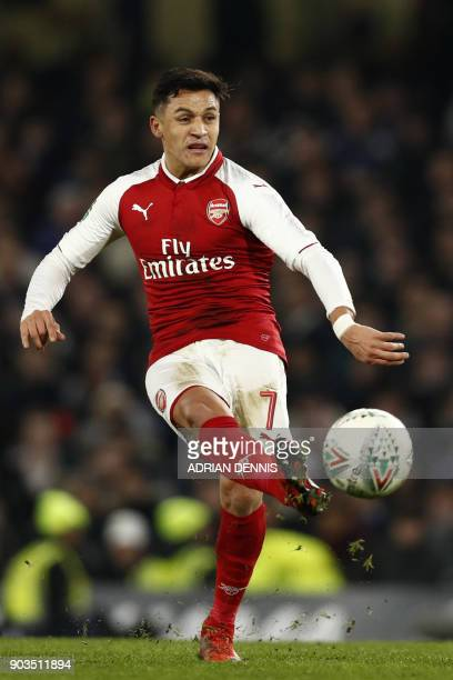 Arsenal's Chilean striker Alexis Sanchez passes the ball during the English League Cup semifinal first leg football match between Chelsea and Arsenal...