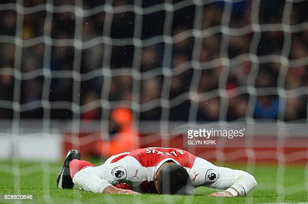 Arsenal's Chilean striker Alexis Sanchez reacts after missing a shot on goal during the English Premier League football match between Arsenal and...
