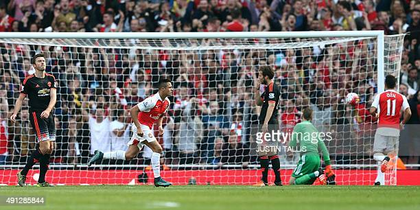 Arsenal's Chilean striker Alexis Sanchez reacts after scoring his second and the team's third goal during the English Premier League football match...