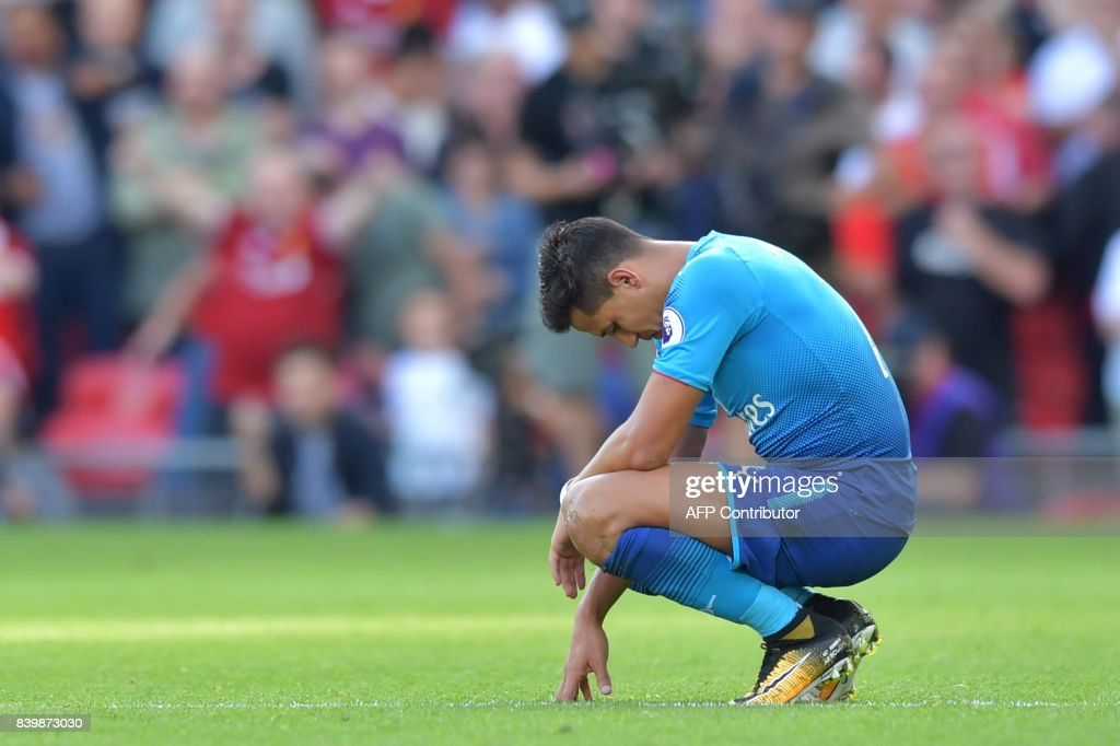 Arsenal's Chilean striker Alexis Sanchez reacts during the English Premier League football match between Liverpool and Arsenal at Anfield in Liverpool, north west England on August 27, 2017. / AFP PHOTO / Anthony Devlin / RESTRICTED TO EDITORIAL USE. No use with unauthorized audio, video, data, fixture lists, club/league logos or 'live' services. Online in-match use limited to 75 images, no video emulation. No use in betting, games or single club/league/player publications. /