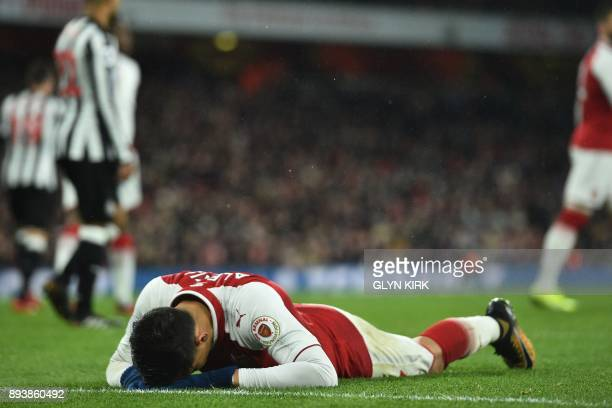 Arsenal's Chilean striker Alexis Sanchez reacts to a missed chance during the English Premier League football match between Arsenal and Newcastle...