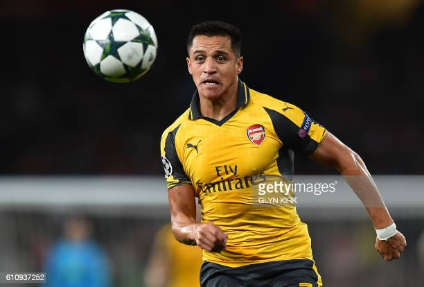 Arsenal's Chilean striker Alexis Sanchez runs with the ball during the UEFA Champions League Group A football match between Arsenal and FC Basel at...