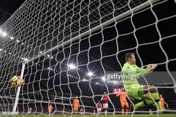 Arsenal's Chilean striker Alexis Sanchez scores the team's first goal past Liverpool's Belgian goalkeeper Simon Mignolet during the English Premier...