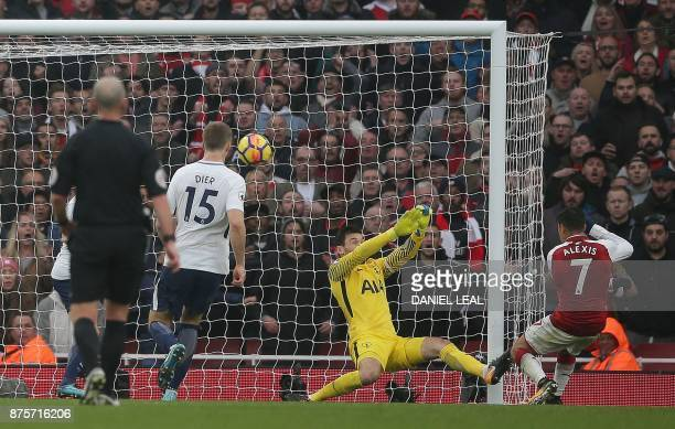 Arsenal's Chilean striker Alexis Sanchez shoots past Tottenham Hotspur's French goalkeeper Hugo Lloris to score his team's second goal during the...