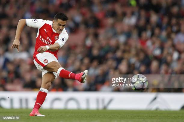 TOPSHOT Arsenal's Chilean striker Alexis Sanchez takes a shot at goal which is disallowed during the English Premier League football match between...