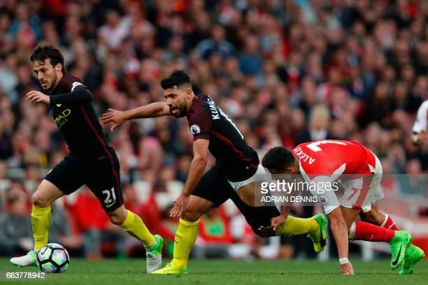 Arsenal's Chilean striker Alexis Sanchez vies with Manchester City's Argentinian striker Sergio Aguero and Manchester City's Spanish midfielder David...