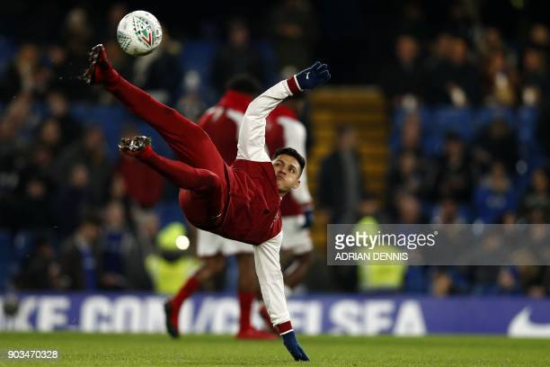 Arsenal's Chilean striker Alexis Sanchez warms up ahead of the English League Cup semifinal first leg football match between Chelsea and Arsenal at...