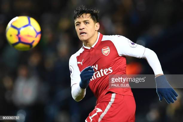 Arsenal's Chilean striker Alexis Sanchez watches the ball during the English Premier League football match between West Bromwich Albion and Arsenal...