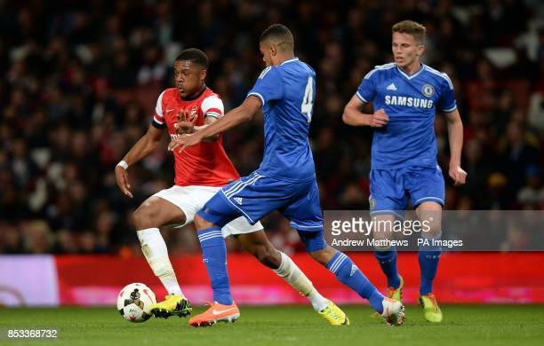 Arsenal's Chuba Akpom gets away from Chelsea's Jake Clarke Salter during the FA Youth Cup Semi Final match at the Emirates Stadium London