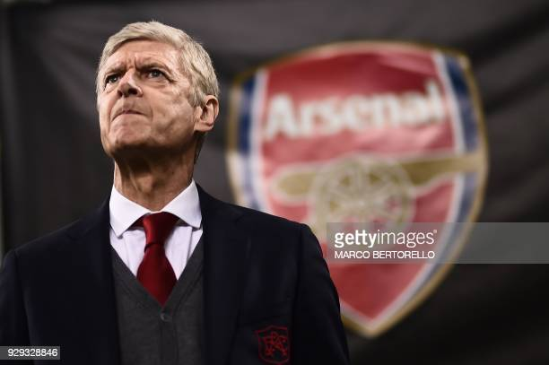 TOPSHOT Arsenal's coach Arsene Wenger from France looks on during the UEFA Europa League round of 16 firstleg football match AC Milan Vs Arsenal at...