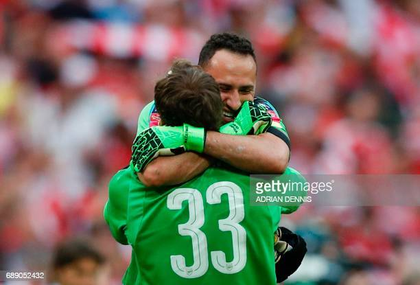 Arsenal's Colombian goalkeeper David Ospina and Arsenal's Czech goalkeeper Petr Cech celebrate on the final whistle of the English FA Cup final...