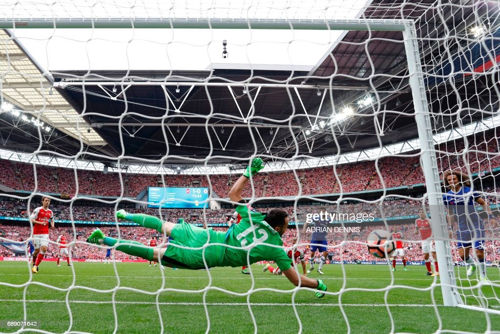 Arsenal's Colombian goalkeeper David Ospina cannot save the shot from Chelsea's Brazilian-born Spanish striker Diego Costa as Chelsea equalize during the English FA Cup final football match between Arsenal and Chelsea at Wembley stadium in London on May 27, 2017. / AFP PHOTO / Adrian DENNIS / NOT