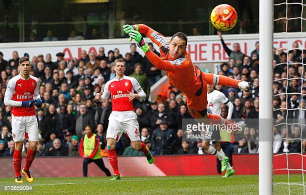 Arsenal's Colombian goalkeeper David Ospina dives but cannot stop the shot from Tottenham Hotspur's English striker Harry Kane as Tottenham take a 21...