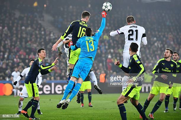 TOPSHOT Arsenal's Colombian goalkeeper David Ospina jumps to make a save during the UEFA Champions league Group A football match between FC Basel...